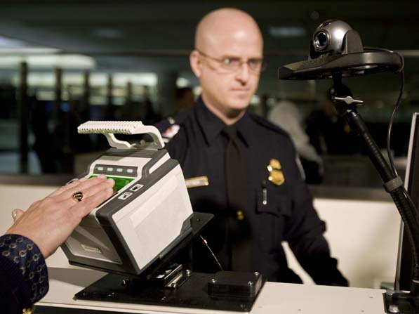 Guardian_border_-patrol_officer_hand_on_scanner.jpg