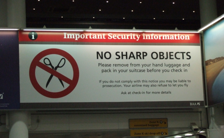No_sharp_objects_sign_at_Gatwick_Airport.jpg