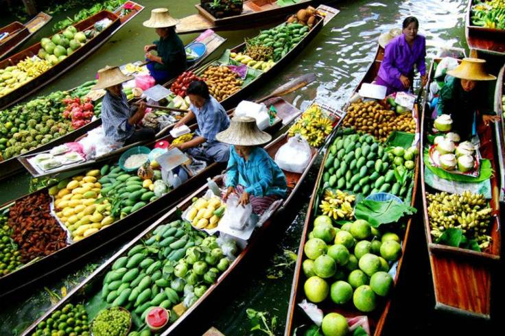 Fruit-piled-high-at-Damnoen-Saduak-Floating-Market.jpg