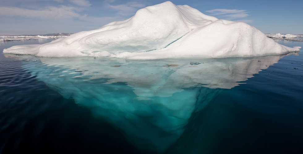 iceberg_in_the_arctic_with_its_underside_exposed_b